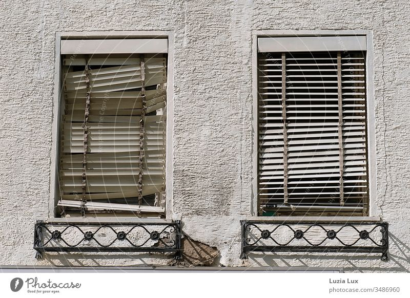 Windows with broken blinds, house wall, shadow play Roller blinds Broken Old roughcast Shadow Sun Sunlight Sun Shadow play Town urban Gloomy transient slanting