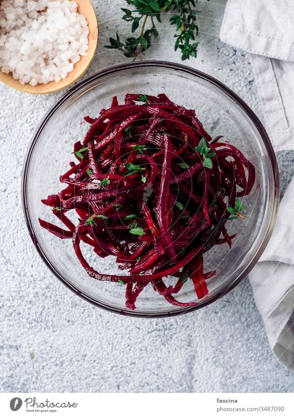 Raw beetroot noodles or beet spaghetti salad diet food fresh healthy lunch plate preparation raw vegan vegetarian appetizer dish vegetable veggie cooking
