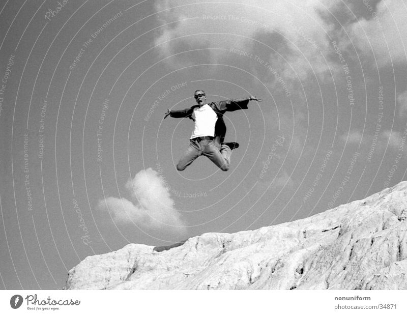 Me, Myself & Eye Jump Clouds Aloof Man Tall Sand Free Joy Black & white photo Freedom Lust Flying Thrill Air Trick jump