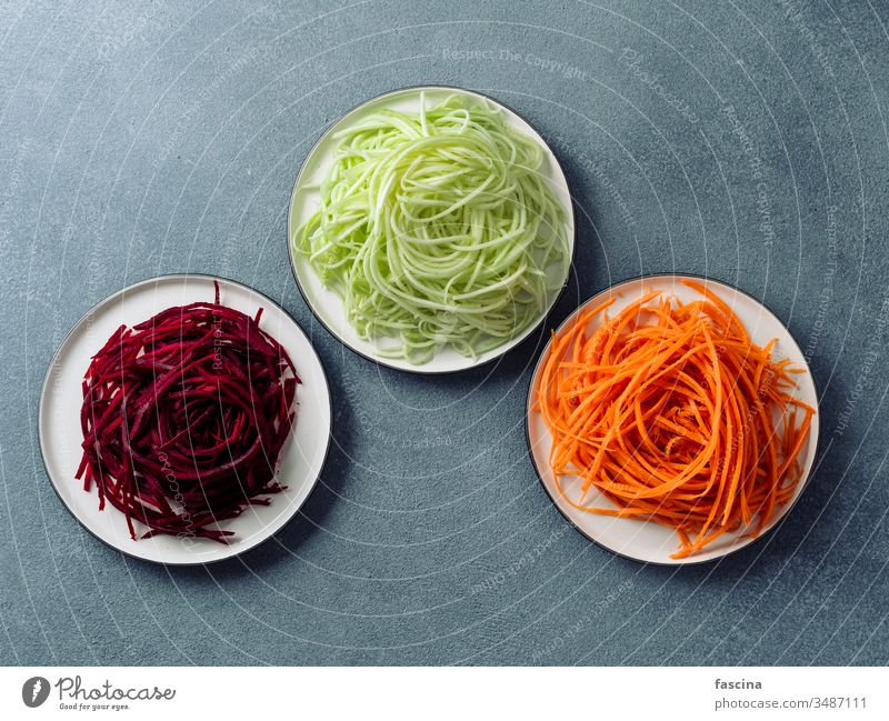 zucchini, carrot, and beetroot noodles, copy space vegan vegetarian raw squash spaghetti zoodles top view clean eating diet food fresh healthy lunch preparation