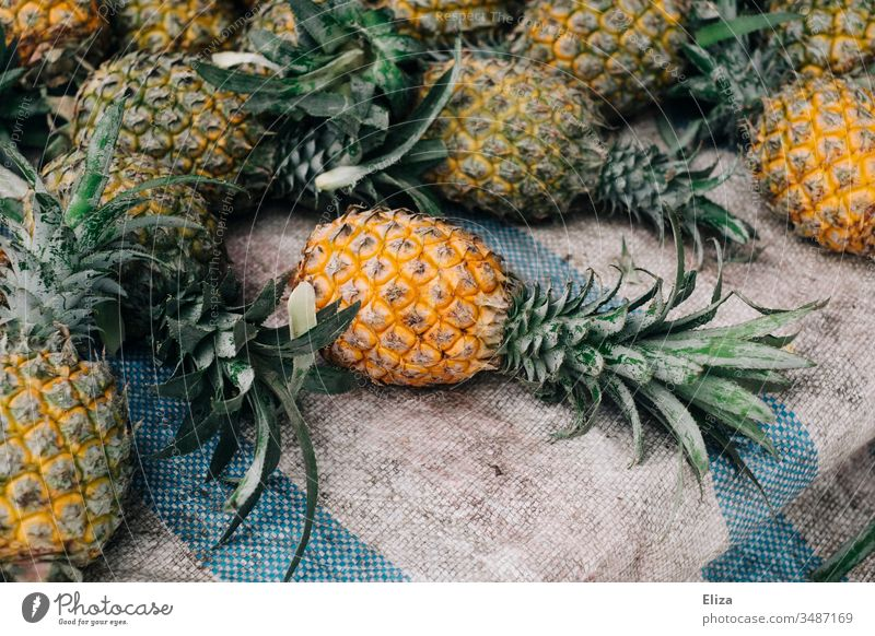 Several whole pineapples at one fruit stand Pineapple Asia Delicious Lie Fruit Nutrition Fresh Colour photo Fruit- or Vegetable stall Deserted Food