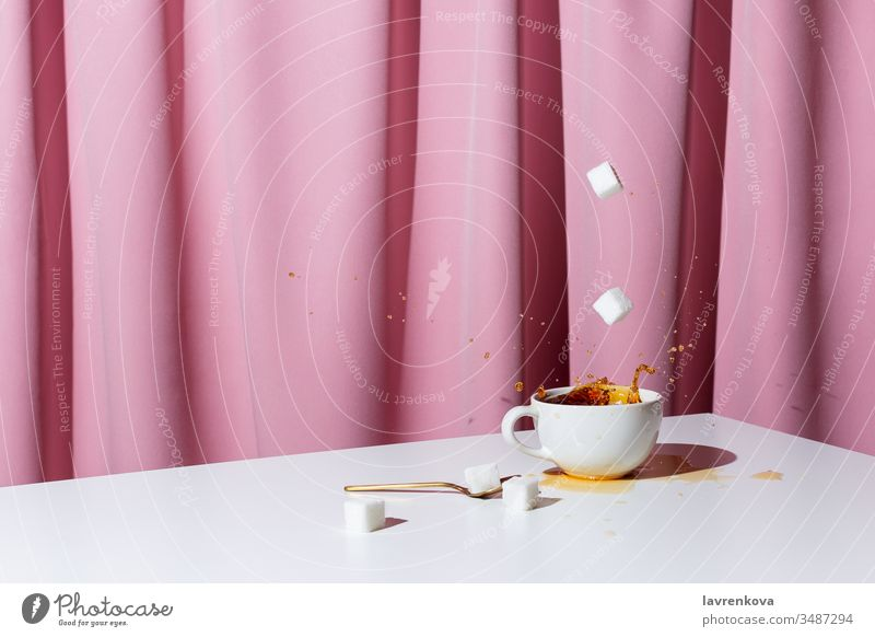 Cup of tea or coffee on white table in front of pink drapery, selective focus caffeine black espresso aroma morning beverage cup curtain drink hand holding hot