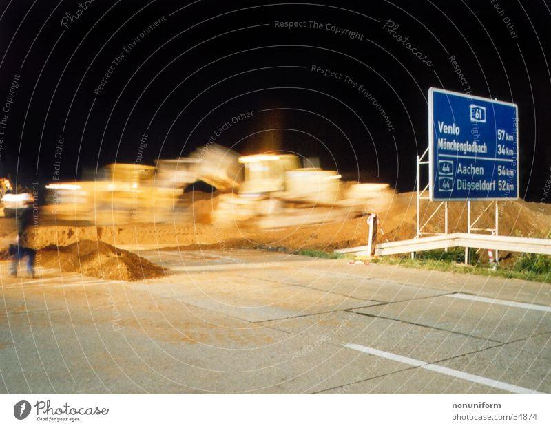 Excavatorcrossing A61 - 2004 - 1 Highway Rhine-Westfalia Electricity Works AG Lignite Night Long exposure Transport bulldozer Sand motorway closure