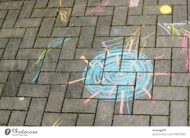 Chalk drawing of Coronavirus on a footpath Children's drawing Childlike Street art variegated Footpath Virus coronavirus risk of contagion Infection