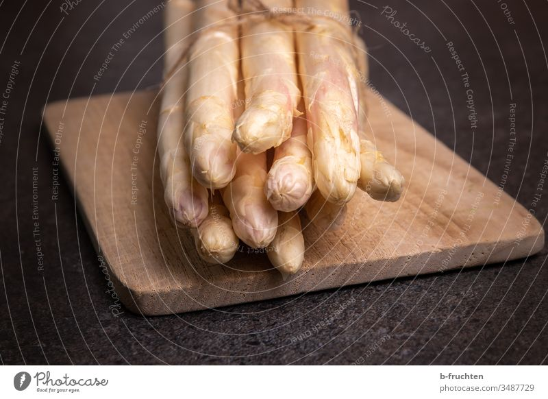 A bunch of white asparagus on a chopping board kitchen board Asparagus Vegetable Food Nutrition Vegetarian diet Healthy Eating Fresh Asparagus season Close-up