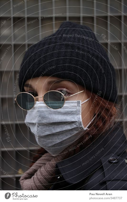 Close up of Woman Covering Her Face With Protective Mask. Virus concept protection medical equipment face mask epidemic coronavirus protective quarantine safe