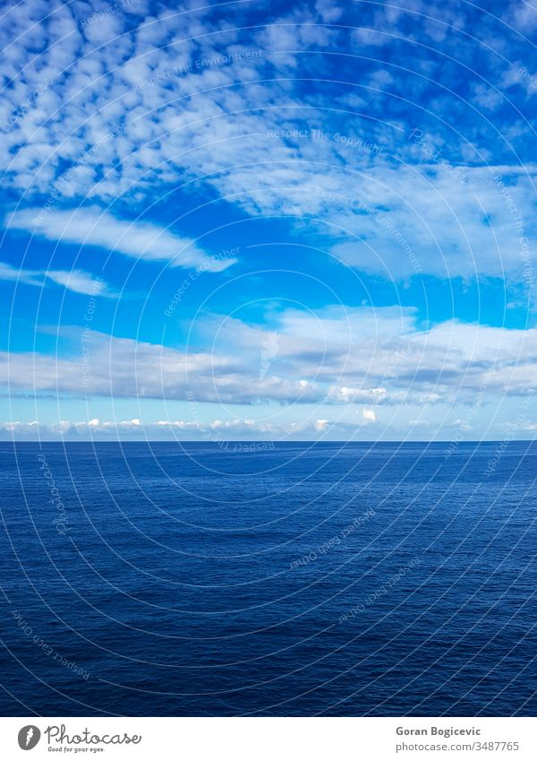 Sea surface above abstract background blue calm clean color liquid nature nobody pattern ripple rippled sea sky view water wave clouds