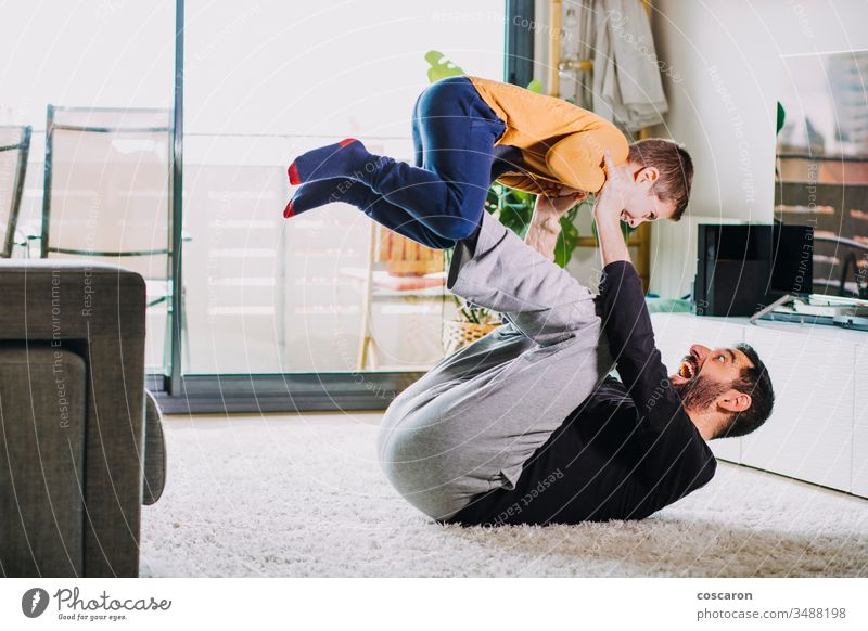 Father and son playing at home adorable air baby bonding boy candid laughter child childcare fun childhood childhood care coronavirus covid-19 dad dad laugh