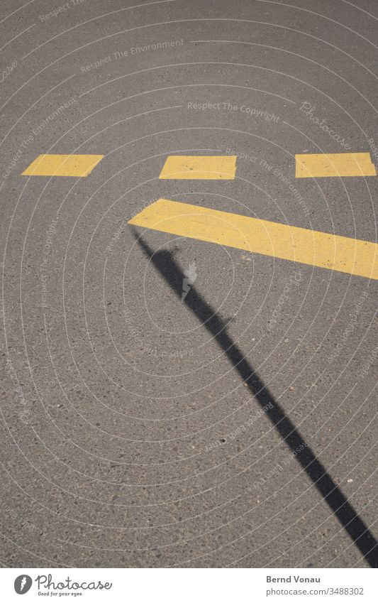 road marking Street Marker line Yellow Black Shadow Gray Asphalt Sunlight Signs and labeling Traffic infrastructure Under three Rectangle Line graphically