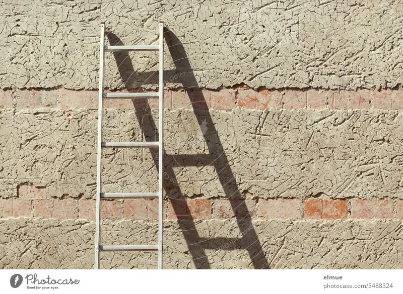 Metal ladder leans against a roughly plastered wall and forms a shadow Ladder career ladder Shadow Wall (building) Hold sprout stop Metal conductor Lean Plaster