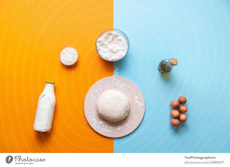 Dough and bake ingredients top view, colorful background above view bakery baking bread baking stone blue dough flat lay flour food food ingredients