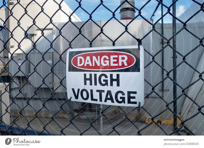 Danger high voltage sign on a fence high-voltage warning sign industrial volts pole entry blue line transformer industry supply current transmission station