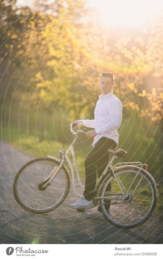 Man rides a bicycle through nature and makes a bicycle tour Cycling Bicycle Cycling tour Sunlight Beautiful weather fun Joy Nature relaxation Love of nature