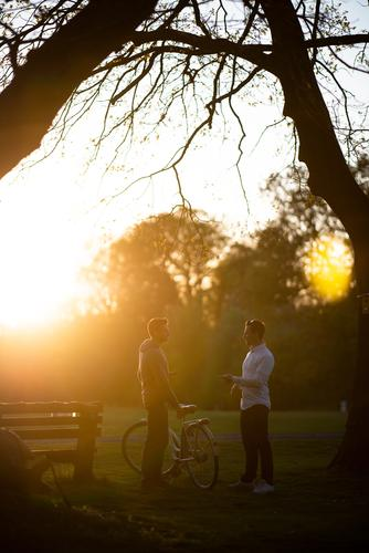 taking a break with the bike sunlight social contacts men talk Cycling Friends Bicycle Friendship maintain meetings Cycling tour Man Sunlight Beautiful weather