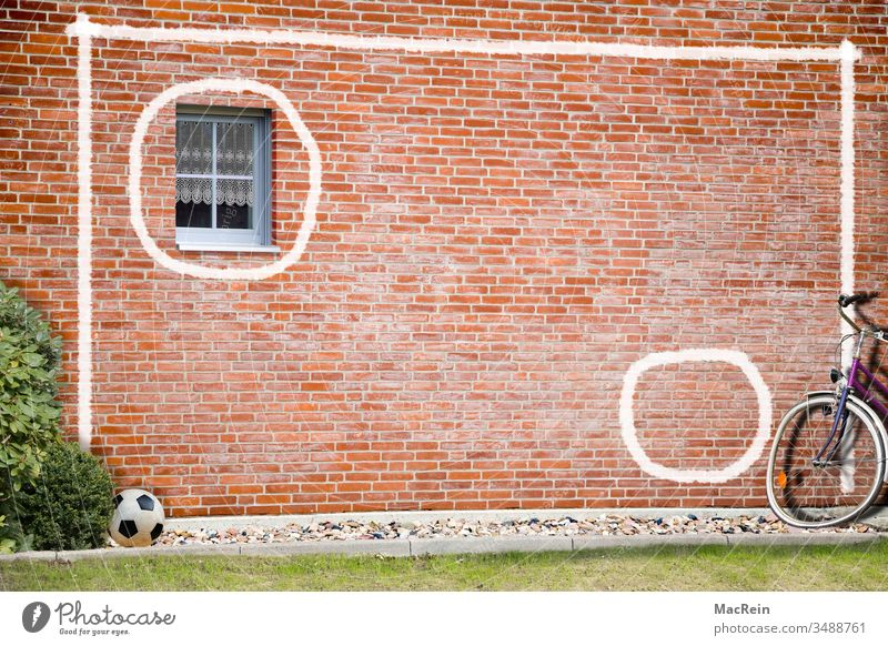 goal wall soccer wall Foot ball Ball workout exercise Bicycle house wall Window Brick wall Wall (building) painting painted on chalk stripes White nobody