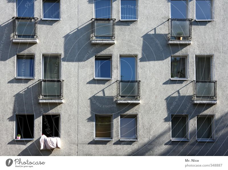 airing Living or residing Flat (apartment) House (Residential Structure) Environment Town High-rise Building Architecture Facade Window Gray Balcony Ventilate