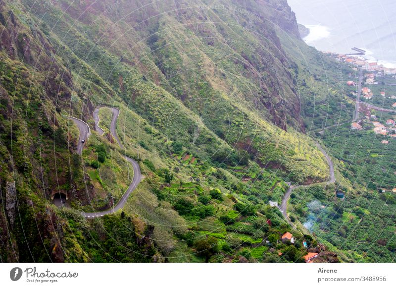 In some places the course of the road gets lost in unclear steep terrain. Winding road steep slope hillside Steep Impassable mountain road hairpin bends