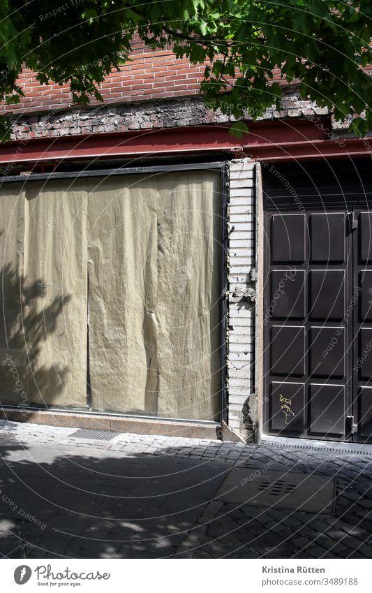 abandoned shop Closed too business Load Shop window Window masked pasted up Facade forsake sb./sth. Task give up bankrupt bankruptcy broke