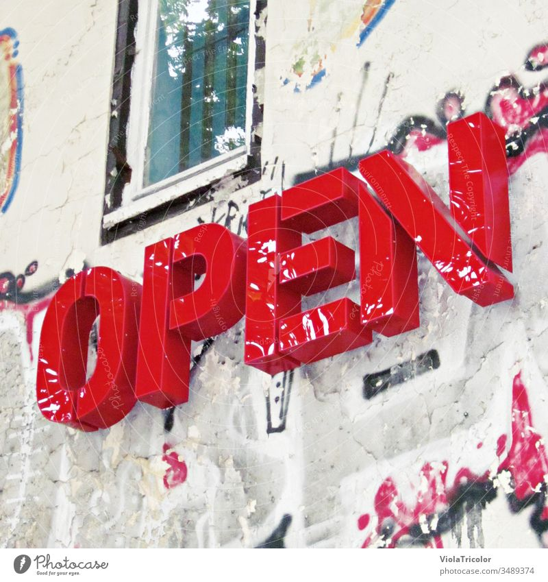 "Open"" lettering on urban facade open Exterior shot Colour photo Signs and labeling Characters Wall (building) Town Day Facade Downtown Closed open again"