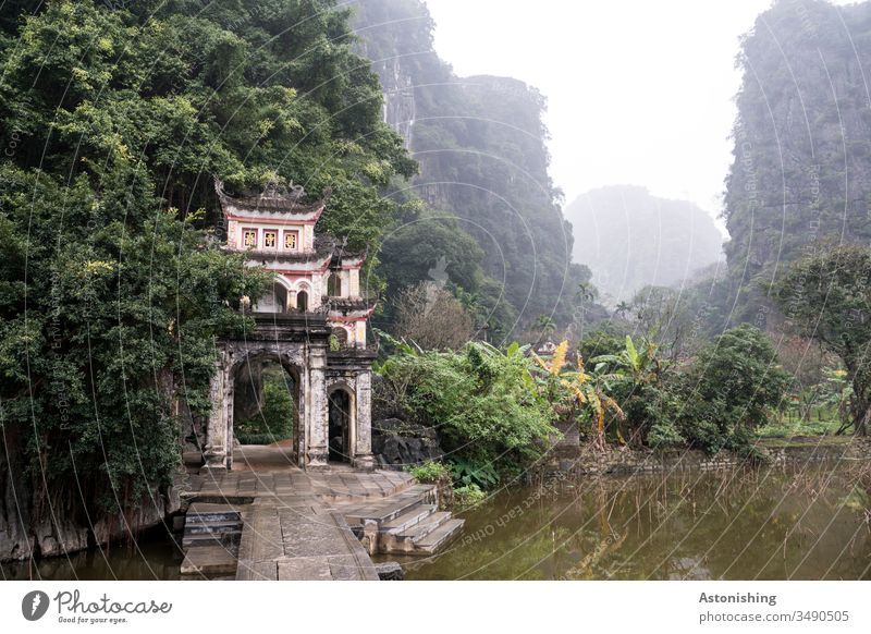 Entrance to a temple complex in Ninh Binh, Vietnam Environment Trip Plant Far-off places Colour photo mountains Nature Exterior shot Mountain Adventure Tourism