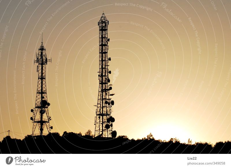 Antenna pylons Sky Sunset Technology Pylon Tower Transmission power Silhouette Orange Electricity Steel Radio (broadcasting) network Equipment Engineering Metal
