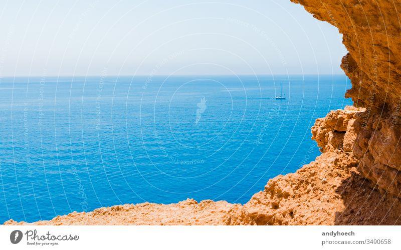 Boat near ibiza a mediterranean island activity adventure blue boat cala cliff coastline cruise destination edge europe Fotoagentur Fotolia fun hobbies Ibiza