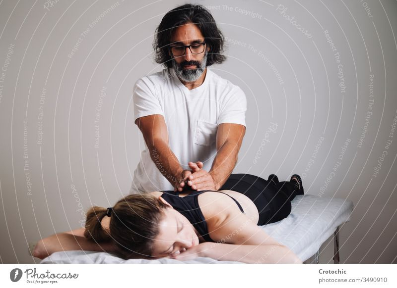 Kinesiology Physiotherapy. Caucasian man attending his clinic. alternative aromatherapy arthritis back being bodycare bone chiropractor cosmetic dayspa doctor