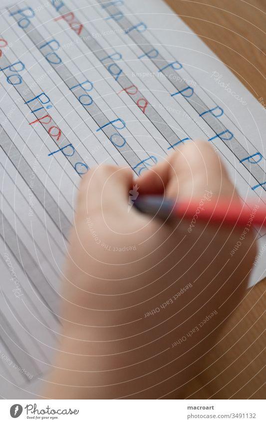 Homeschooling homeschooling schule zu hause heimunterricht silbenstift rot blau kinderhand deutsch schreiben druckschrift druckbuchstaben hausunterricht