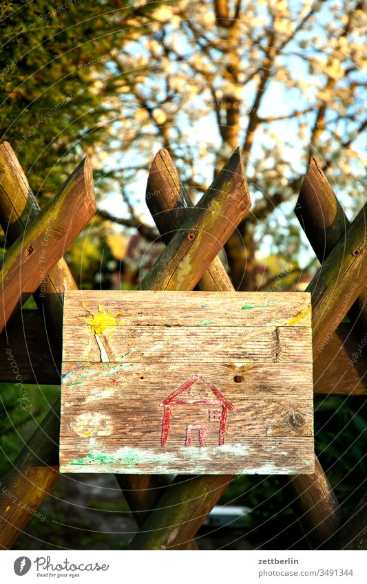 Child picture at the garden fence Fence Garden fence neighbourhood Neighbor Wooden fence hunting fence Branch Tree Flower blossom Blossom spring Spring Border