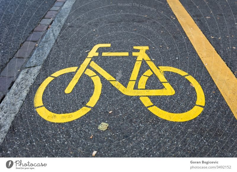 Yellow bicycle sign path on the road yellow drive symbol street urban way lane bike pathway information marking biking asphalt transport city ground town line