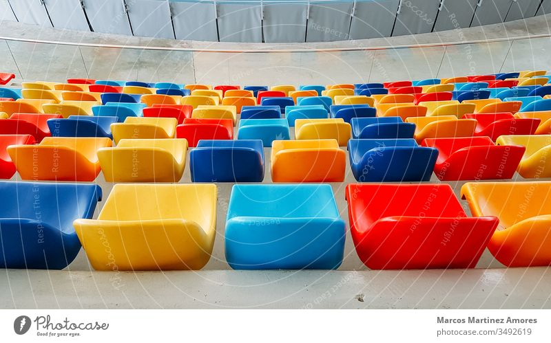 multicolored seats , multicolored seats,Colorful seating spectator sitting presentation empty conference stadium meeting gathering public backrest indoor event
