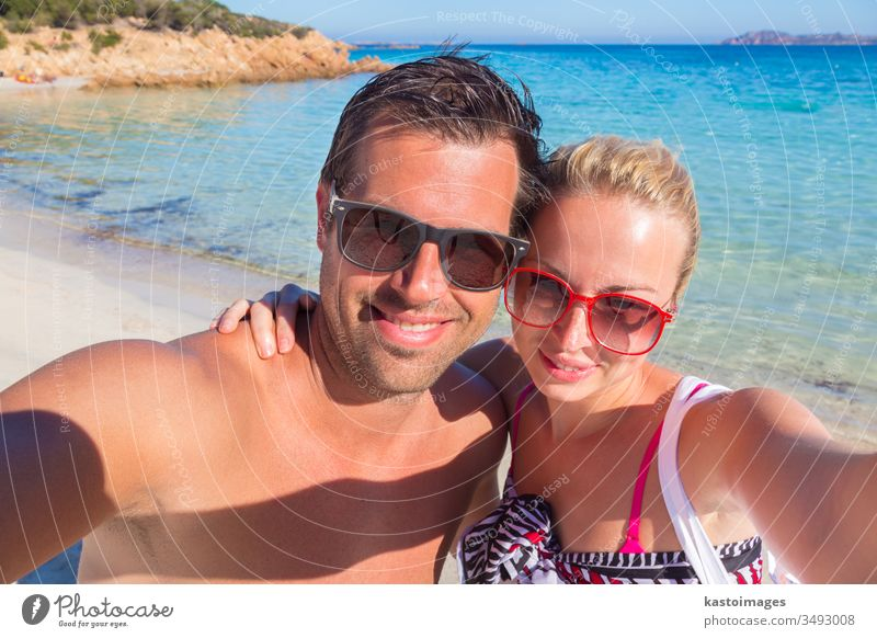 Summer holidays selfie. couple summer vacation smile turquoise woman beach sand sea girl person female self portrait beauty tropical travel leisure sexy