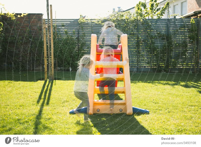 Girl plays in the garden and slides down the slide girl Child Garden Playing Skid Infancy Toddler Happiness Summer cheerful luck Human being Cute creatively