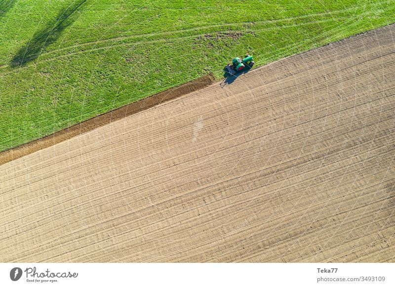 tractor digs a field from above tractor from above historic tractor green tractor tractor on a field agricultural agricultural way tractor path field background