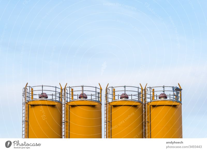 Four silos in front of blue sky abstract any Background building industry Business clear sky concept construction construction site copy space day design