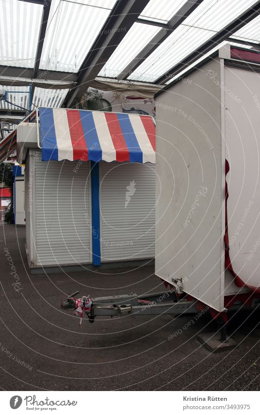 closed market stalls Markets market stands Market stall booths Marketplace Closed too closure Roller shutter roller shutter shutters Sun blind Red White Blue