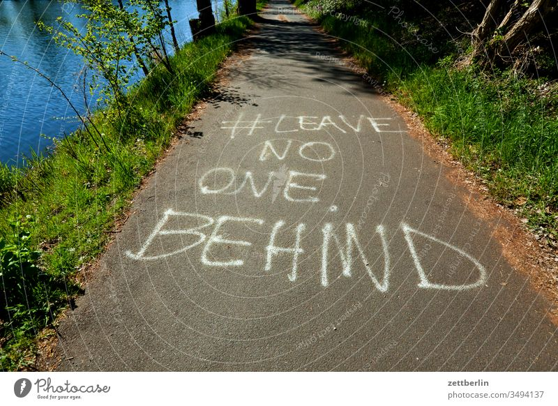 LEAVE NO ONE BEHIND leave no on behind Solidarity call Context Humanity Company hash day pencil tagg slogan embassy Remark Message off hiking trail bank