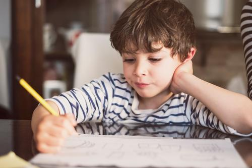 4 years old doing homework at home boy child education infant math writing addition subtraction 4 year old 4s childhood sitting active activity learning kid