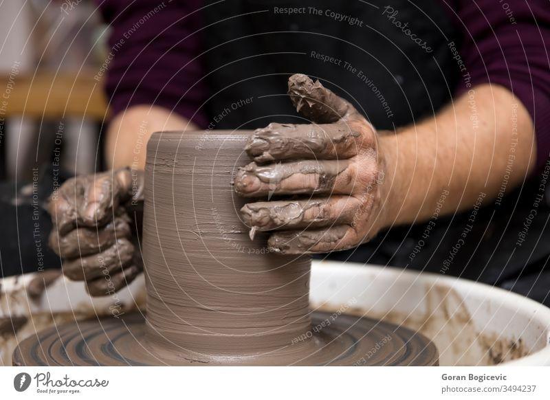 Artist makes clay pottery on a spin wheel art artist bowl ceramic craft creating creation creative creativity dirty finger form hand handmade making