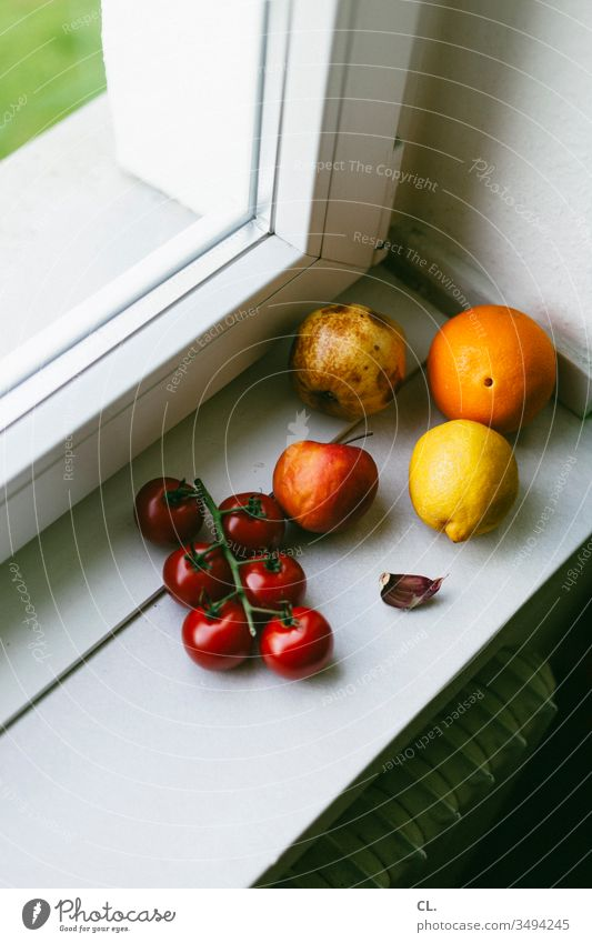 fruit on windowsill Lemon Apple Orange Tomato salubriously Delicious Eating vitamins Window Healthy Food Nutrition Natural Vegetarian diet Interior shot