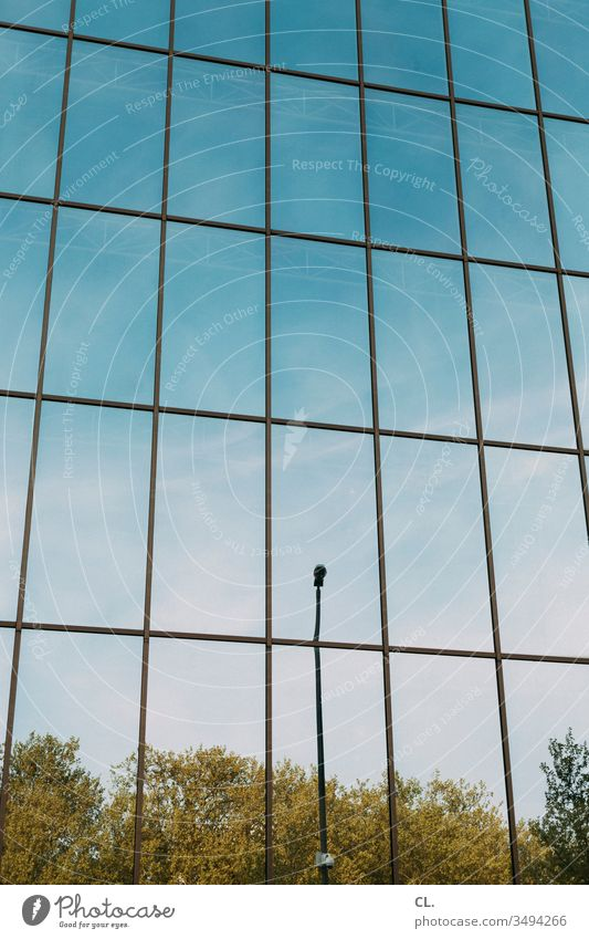 mirror facade Facade Mirror Architecture Precision Accuracy lines streetlamp built Town Structures and shapes Esthetic Abstract Day Sky Blue sky huts Modern
