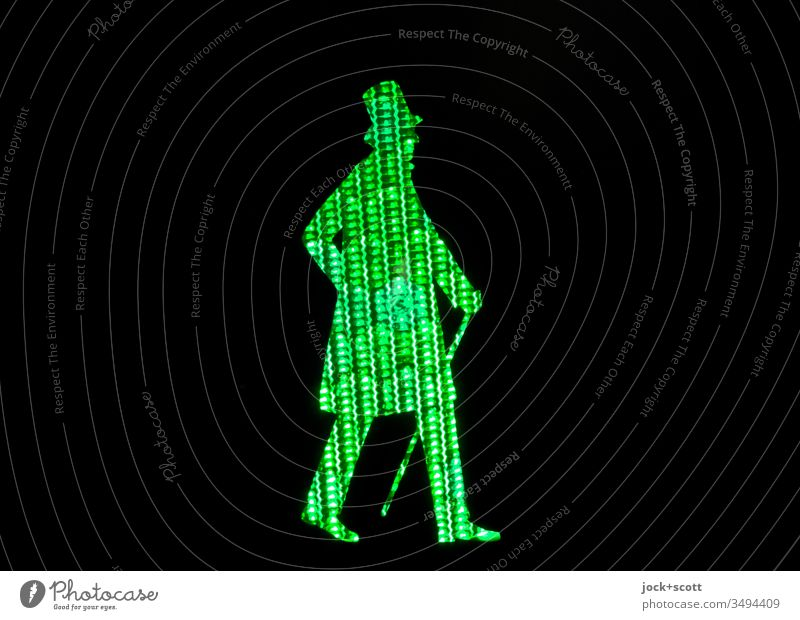 Dane on the way across the road Green Profile Silhouette Artificial light Structures and shapes Pictogram Diffused light Comic Safety Traffic light Pedestrian