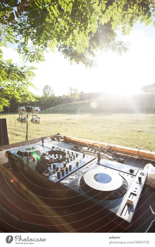Party in nature - sunset discotheque on open field party summer celebration stage show vacation holiday music DJ equipment dance glow tree travel fun concert