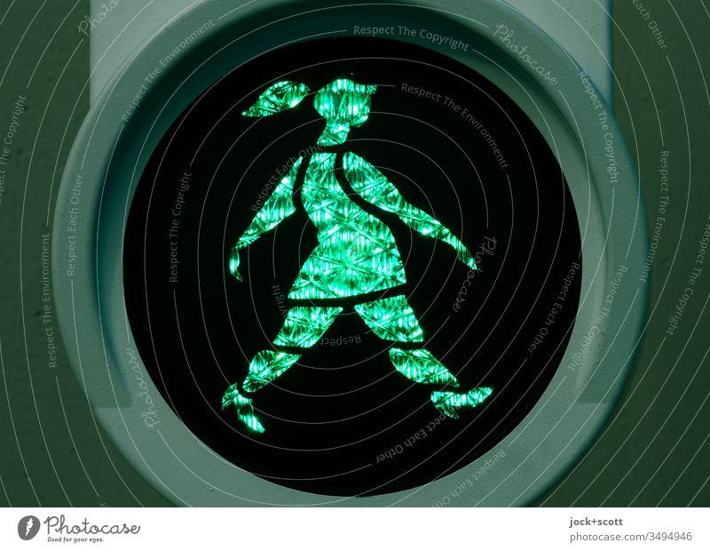 Dutchwoman goes swinging at green Pedestrian traffic light ampelmännchen Back-light visually Design Symbols and metaphors Light (Natural Phenomenon) Silhouette