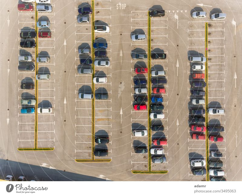 Cars on parking car vehicle row lot asphalt transport road view automobile garage urban transportation public street background traffic line nobody cars outside