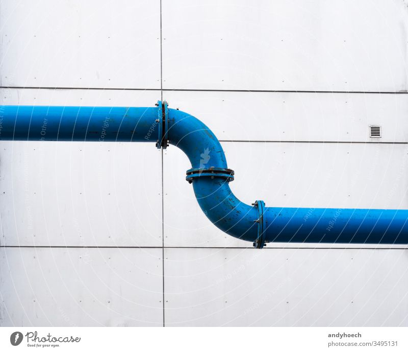 A water pipeline across the city in front of a plain facade architecture Background blue building building exterior built structure connected connecting