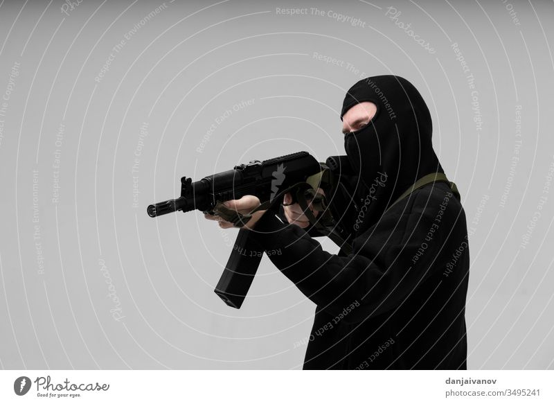 Man in mask With gun on white background aggression armed balaclava black crime criminal danger evil hand holding isolated killer male men murder people person
