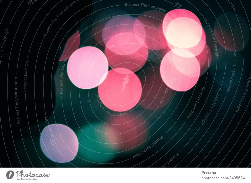 A Bokeh image of Christmas lights with blue pink and teal colors bokeh bokeh lights bokeh background Sky Pink Blue Christmas decoration Bulb Wallpaper