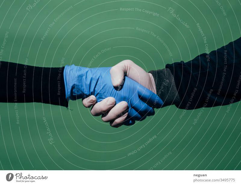 Protected handshake shake hands Deal Gloves Latex gloves coronavirus Protection Corona protection pandemic coronavirus SARS-CoV-2 covid-19 COVID
