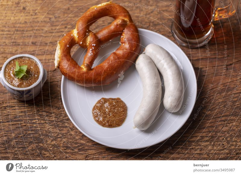 Bavarian white sausages with pretzel Veal sausage Mustard Pretzel Plate Beer bright Beer mug Glass Pot two Couple Oktoberfest Eating White Munich Breakfast